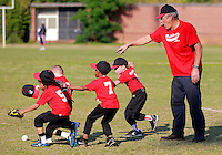 Billy Martin directs his tee ball players to a ground ball during a game at the old McCants field in Anderson. Martin has coached tee ball and youth baseball for the Anderson Parks and Recreation Department's leagues for about 30 years.