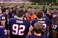 Virginia Cavaliers head coach Mike London talks with his players after the 30-24 loss to Southern Miss at Scott Stadium.  (Photo/Andrew Shurtleff)