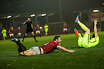 © Joel Goodman - 07973 332324 . 14/11/2015 . Manchester , UK . FC United captain LIAM BROWNHILL (l) slides on the wet pitch after losing the ball to Gainsborough's JAMIE YATES (r) , in the dying minutes of the match . FC United host Gainsborough Trinity in the National League North at Broadhurst Park . NB requested changing room access three times and was denied three times . Photo credit : Joel Goodman