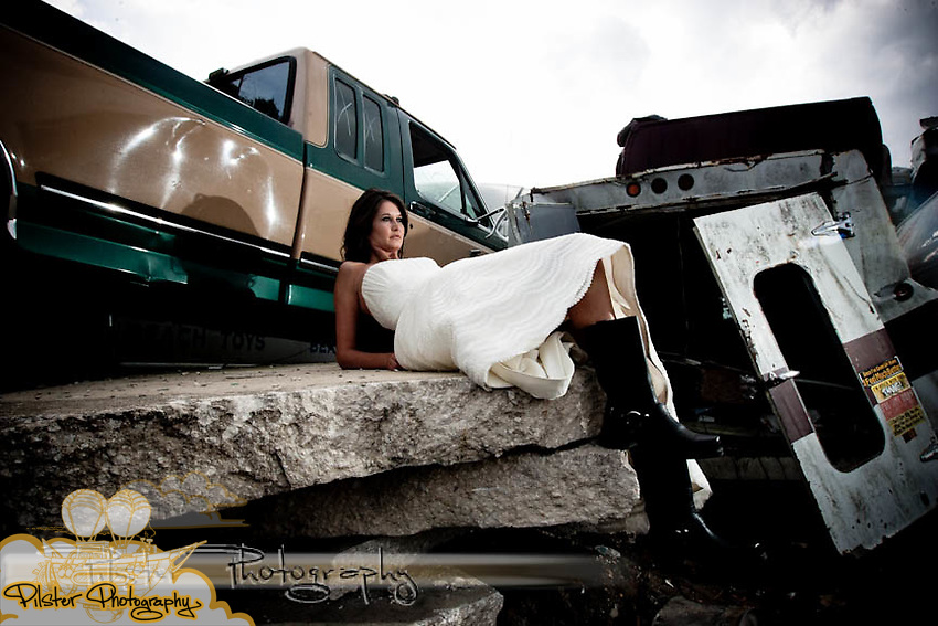Jessica Steck Tuesday, April 20, 2010, during a trash the dress shoot at the U Pull It in DeLand, Florida. The dress is a Vera Wang from The Collection, hair by Rachel Ellerby and Makeup by Camila Santos.  (Chad Pilster, http://www.PilsterPhotography.net.)