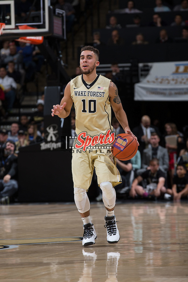 Mitchell Wilbekin (10) of the Wake Forest Demon Deacons brings the ball up the court during first half action against the Duke Blue Devils at the LJVM Coliseum on January 6, 2016 in Winston-Salem, North Carolina.  The Blue Devils defeated the Demon Deacons 91-75.  (Brian Westerholt/Sports On Film)