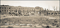 BNPS.co.uk (01202 558833)<br /> Pic: Pen&amp;Sword/BNPS<br /> <br /> Tug-of-war at Whit Monday Sports, outside the infantry barracks.<br /> <br /> A poignant collection of images which were taken by a photographer who documented the graves of fallen soldiers on the Western Front have come to light in a new book.<br /> <br /> Ivan Bawtree was one of only three professional photographers assigned to the the Graves Registration Units to photograph and record the graves of fallen First World War soldiers on behalf of grieving relatives. <br /> <br /> His powerful photos of northern France and Flanders are a haunting reminder of the horrors of war and a fascinating insight into the early work of the Imperial War Graves Commission. <br /> <br /> Prior to the First World War, the casualties of war were generally buried in unmarked mass graves.