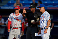 Florida Fire Frogs manager Barrett Kleinknecht (24) during the lineup exchange with Chad Kreuter (29) and umpire Dexter Kelley (right) before a Florida State League game against the St. Lucie Mets on April 12, 2019 at First Data Field in St. Lucie, Florida.  Florida defeated St. Lucie 10-7.  (Mike Janes/Four Seam Images)
