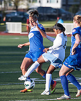 Chicago Red Stars midfielder/foward Zakiya Bywaters (6) dribbles the ball away from Boston Breakers forward Lianne Sanderson (10) and Boston Breakers forward Katie Schoepfer (12).  In a National Women's Soccer League Elite (NWSL) match, the Boston Breakers defeated  Chicago Red Stars 4-1, at the Dilboy Stadium on May 4, 2013.