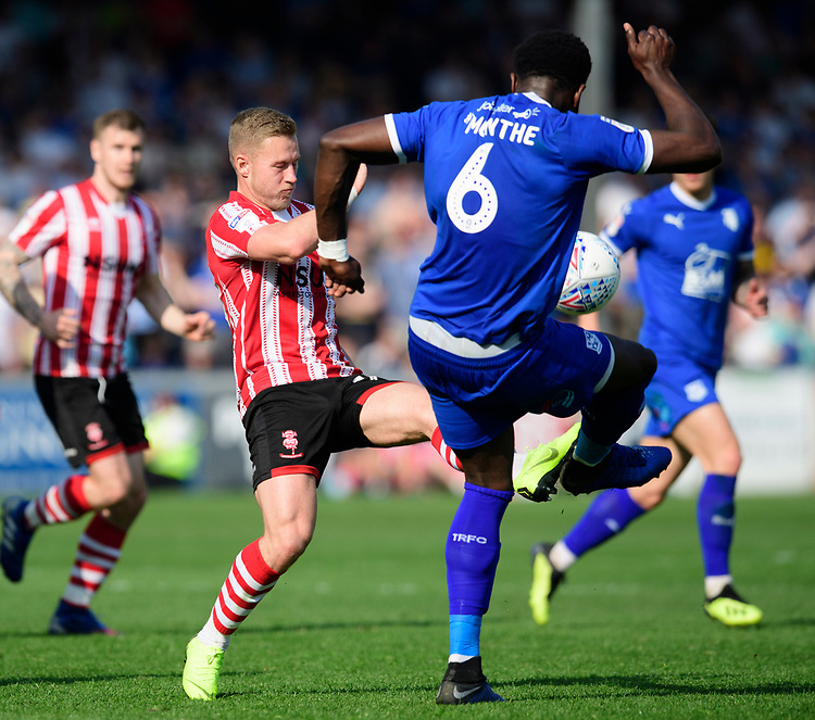 Lincoln City's Danny Rowe vies for possession with Tranmere Rovers' Emmanuel Monthe<br /> <br /> Photographer Chris Vaughan/CameraSport<br /> <br /> The EFL Sky Bet League Two - Lincoln City v Tranmere Rovers - Monday 22nd April 2019 - Sincil Bank - Lincoln<br /> <br /> World Copyright © 2019 CameraSport. All rights reserved. 43 Linden Ave. Countesthorpe. Leicester. England. LE8 5PG - Tel: +44 (0) 116 277 4147 - admin@camerasport.com - www.camerasport.com
