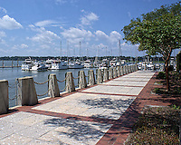 This is Beaufort Harbor sporting a fairly new walkway which is part of Beaufort's harbor park. Hidden by the shade trees are a few swing gliders where you can sit an enjoy a super view of the boats, water and picturesque harbor.