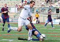 Andrew Marshall #5 of Crystal Palace Baltimore slides the ball away from Eduardo Sebrano #12 of the Montreal Impact during an NASL match at Paul Angelo Russo Stadium in Towson, Maryland on August 21 2010. Montreal won 5-0.