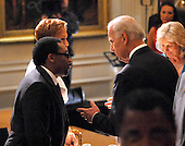 "Washington, D.C. - May 12, 2009 -- United States Vice President Joseph Biden shares some thoughts with Spike Lee as they await the arrival of U.S. President Barack Obama and first lady Michelle Obama for ""An Evening of Poetry, Music and the Spoken Word in the East Room of the White House in Washington, DC on Tuesday, May 12, 2009..Credit: Ron Sachs / Pool via CNP"