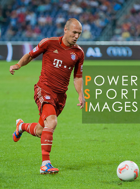 Arjen Robben of Bayern Munich in action during a friendly match against VfL Wolfsburg as part of the Audi Football Summit 2012 on July 26, 2012 at the Guangdong Olympic Sports Center in Guangzhou, China. Photo by Victor Fraile / The Power of Sport Images