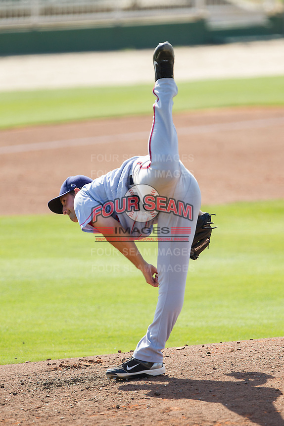 Hagerstown Suns relief pitcher Robert Orlan (40) follows through on his delivery against the Kannapolis Intimidators at CMC-Northeast Stadium on June 1, 2014 in Kannapolis, North Carolina.  The Intimidators defeated the Suns 5-1 in game one of a double-header.  (Brian Westerholt/Four Seam Images)