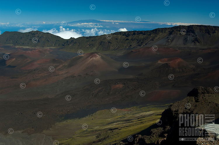 Maui's Haleakala Crater late on a spectacularly clear day, with the Big Island's Mauna Kea and Mauna Loa visible in the background.