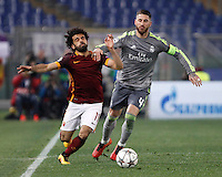 Calcio, andata degli ottavi di finale di Champions League: Roma vs Real Madrid. Roma, stadio Olimpico, 17 febbraio 2016.<br /> Roma's Mohamed Salah, left, and Real Madrid's Sergio Ramos fight for the ball during the first leg round of 16 Champions League football match between Roma and Real Madrid, at Rome's Olympic stadium, 17 February 2016.<br /> UPDATE IMAGES PRESS/Isabella Bonotto