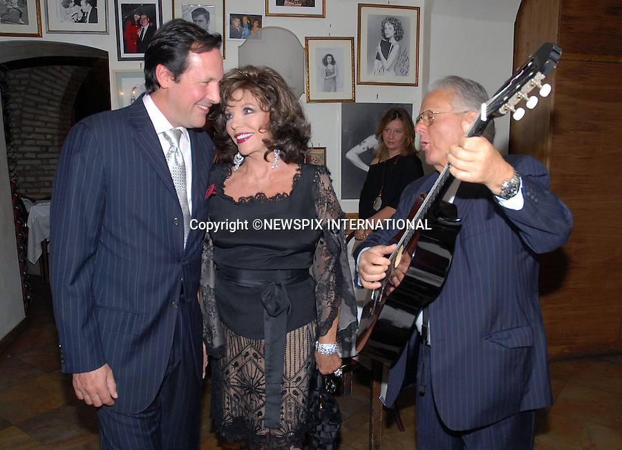 "JOAN COLLINS AND PERCY GIBSON.enjoy a romantic dinner at ""Taverna Flavia"", where they were serenaded by a guitarist..Joan Collins had earlier appeared in the new Italian TV programme ""Tutti pazzi per la tele"", "" on Raiuno, Rome.Mandatory Credit Photo: ©NEWSPIX INTERNATIONAL..**ALL FEES PAYABLE TO: ""NEWSPIX INTERNATIONAL""**..IMMEDIATE CONFIRMATION OF USAGE REQUIRED:.Newspix International, 31 Chinnery Hill, Bishop's Stortford, ENGLAND CM23 3PS.Tel:+441279 324672  ; Fax: +441279656877.Mobile:  07775681153.e-mail: info@newspixinternational.co.uk"