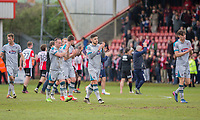 Grimsby players clap their travelling supporters at full time of the Sky Bet League 2 match between Cheltenham Town and Grimsby Town at the The LCI Rail Stadium,  Cheltenham, England on 17 April 2017. Photo by PRiME Media Images / Mark Hawkins.