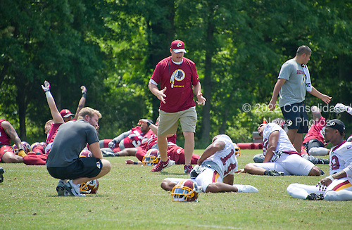 Washington Redskins head coach Jay Gruden looks on as his team participates in an organized team activity (OTA) at Redskins Park in Ashburn, Virginia on Wednesday, June 1, 2016.<br /> Credit: Ron Sachs / CNP