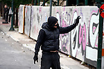 Protesters clash with the riot police, throw petrol bombs and stone against them. General strike in Greece as unions protest new labor reforms amid persisting austerity.