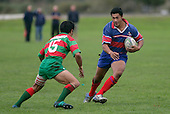 O. Laqtatasi about to tackle V. Fatu. Counties Manukau Premier Club Rugby, Ardmore Marist vs Waiuku played at Bruce Pulman Park, Papakura on the 29th of April 2006. Ardmore Marist won 10 - 9.