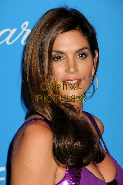CINDY CRAWFORD.UNICEF Ball 2009 Honoring Jerry Weintraub held at the Beverly Wilshire Hotel, Beverly Hills, California, USA..December 10th, 2009.headshot portrait gold hoop earrings  purple sequins sequined .CAP/ADM/BP.©Byron Purvis/AdMedia/Capital Pictures.