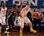 BROOKINGS, SD - OCTOBER 29:  Reed Telinghuisen #23 from South Dakota State picks up the loose ball in front of Jaisean Jackson #5 from South Dakota School of Mines in the second half of their exhibition game Thursday night at Frost Arena in Brookings. (Photo by Dave Eggen/Inertia)