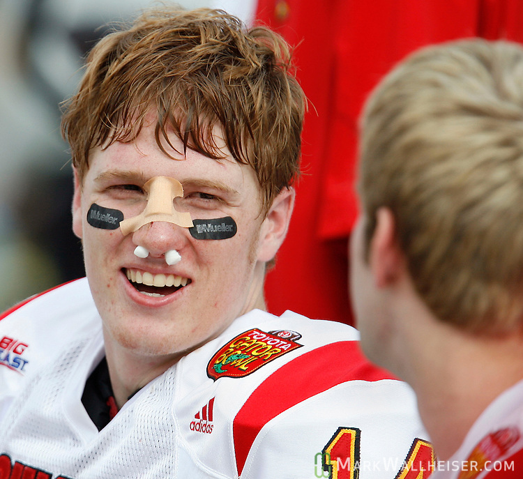 University of Louisville quarterback Hunter Cantwell (L) laughs it up with a teammate on the bench despite his broken nose during his team's game against Virginia Tech in the Toyota Gator Bowl January 2, 2006 in Jacksonville, Florida.  Cantwell missed one play before returning to the game.    (Mark Wallheiser/TallahasseeStock.com)