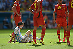 Lionel Messi (ARG), Eden Hazard (BEL),<br /> JULY 5, 2014 - Football / Soccer :<br /> Lionel Messi of Argentina sits on the pitch after being fouled during the FIFA World Cup Brazil 2014 Quarter-finals match between Argentina 1-0 Belgium at Estadio Nacional in Brasilia, Brazil. (Photo by FAR EAST PRESS/AFLO)