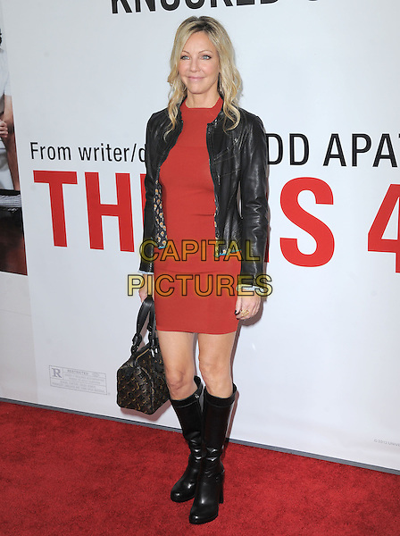 "Heather Locklear.""This Is 40"" Los Angeles Premiere held at Grauman's Chinese Theatre, Hollywood, California, USA..December 12th, 2012.full length black leather jacket red dress boots bag purse .CAP/DVS.©DVS/Capital Pictures."