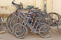 Bicycles parked against wall, Jaisalmer, India.