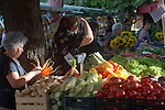 Slovenia, Ljubljana, Old Town or Staro Mesto, open air vegetable market, morning set up, pedestrian friendly, car-free environment, Europe, European Union
