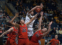 Reshanda Gray of California fights for a loose ball against Oregon State defenders during the game at Haas Pavilion in Berkeley, California on January 3rd, 2014.  California defeated Oregon State, 72-63.