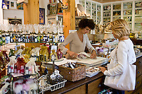 Shopper buying at artisan soaps Martin de Candre specialist savon shop Mestre at Fontevraud L'Abbaye, Loire Valley, France