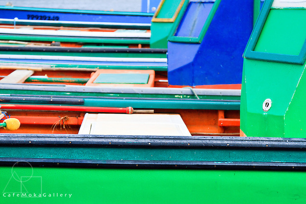 Patterns and colours created by a line of fishing boats