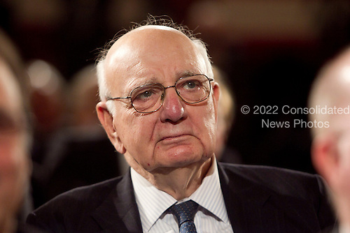 Paul Volcker, chairman of United States President Barack Obama's Economic Recovery Advisory Board, listens as Obama speaks at the U.S. Chamber of Commerce in Washington, D.C., U.S., on Monday, February 7, 2011. Obama said various loopholes and carve-outs distort economic decisions. He drew attention to the way that the deduction for interest encourages companies to borrow rather than invest with equity. .Credit: Andrew Harrer / Pool via CNP