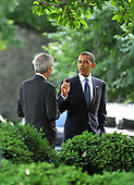 "Washington, D.C. - June 22, 2009 -- United States President Barack Obama, right, shares a ""private"" conversation with U.S. Senator Jeff Bingaman (Democrat of New Mexico), left, as he departs the Rose Garden of the White House after signing the Family Smoking Prevention and Tobacco Control Act on Monday, June 22, 2009..Credit: Ron Sachs - Pool via CNP"