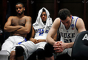 Josh Hairston, Quinn Cook, and Miles Plumlee reflect in the locker room after the game. Lehigh defeated Duke 75-70 during the 2nd round of the 2012 NCAA Basketball Championship at the Greensboro Coliseum in Greensboro, NC. Photo by Al Drago.