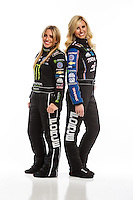 Feb 10, 2016; Pomona, CA, USA; NHRA top fuel driver Brittany Force (left) poses for a portrait with sister, funny car driver Courtney Force during media day at Auto Club Raceway at Pomona. Mandatory Credit: Mark J. Rebilas-USA TODAY Sports