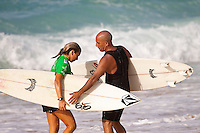 HALEIWA, HI (Nov. 28, 2009) --  Coco Ho (HAW) with father Michael Ho (HAW) The WCT Gidget Pro at Sunset Beach was won today by Hawaiin surfer Carissa Moore (HAW). Runner up was Sally Fitzgibbons (AUS) with newly crown 2009 World Professional Surfing Champion Stephanie Gilmore (AUS) with Alana Blanchard (HAW) in fourth...Gilmore won the 2009 Title when Coco Ho (HAW) failed to advance from the semi finals. It is Gilmore's third straight world title win... The northern hemisphere winter months on the North Shore signal a concentration of surfing activity with some of the best surfers in the world taking advantage of swells originating in the stormy Northern Pacific. Notable North Shore spots include Waimea Bay, Off The Wall, Backdoor, Rocky Point, Log Cabins, Rockpiles and Sunset Beach... Ehukai Beach is more  commonly known as Pipeline and is the most notable surfing spot on the North Shore. It is considered a prime spot for competitions due to its close proximity to the beach, giving spectators, judges, and photographers a great view...The North Shore is considered to be one the surfing world's must see locations and every December hosts three competitions, which make up the Triple Crown of Surfing. The three men's competitions are the Reef Hawaiian Pro at Haleiwa, the O'Neill World Cup of Surfing at Sunset Beach, and the Billabong Pipeline Masters. The three women's competitions are the Reef Hawaiian Pro at Haleiwa, the Gidget Pro at Sunset Beach, and the Billabong Pro on the neighboring island of Maui...Photo: Joliphotos.com