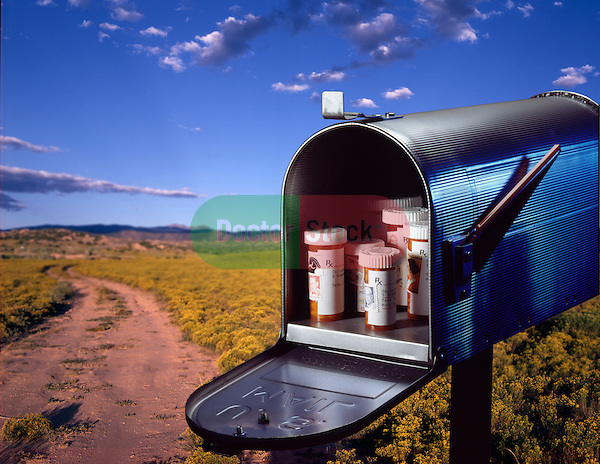 mailbox opened with variety of prescription pill bottles inside mailorder prescriptions