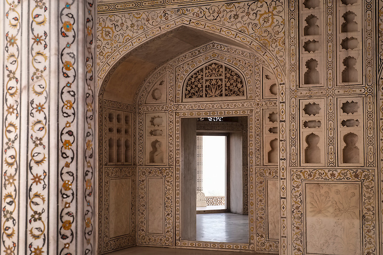The fortified royal residence inside Agra's Red Fort is adorned with intricate, stylized decor.