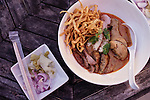 CHIANG MAI, THAILAND JAN 2014:<br /> Kao Soy Nimman, In a lantern-hung courtyard, nine variations of Chiang Mai&rsquo;s must-try signature dish, khao soi, a wheat noodle, curry-based soup, are served, ranging from classic chicken thigh to pork sausage (from 50 Thai baht). There&rsquo;s also a host of other northern specialties to sample, like sweet pork curry and chili dips with vegetables. Nimmanhaemin Rd./Soi 7<br /> @Giulio Di Sturco