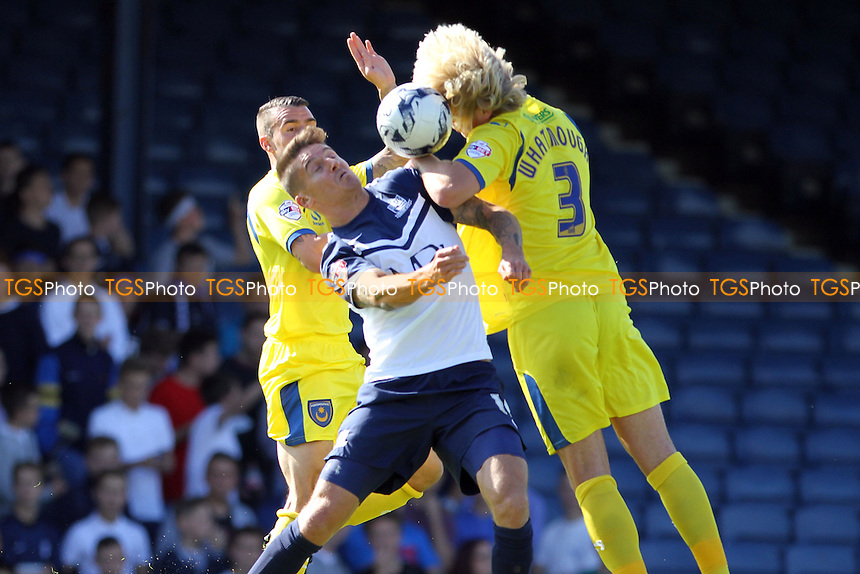 Jack Whatmough (Portsmouth) jumps for the ball with Barry Corr (Southend United - Southend United vs Portsmouth - Sky Bet League Two Football at Roots Hall, Southend on Sea, Essex - 13/09/14 - MANDATORY CREDIT: Mick Kearns/TGSPHOTO - Self billing applies where appropriate - contact@tgsphoto.co.uk - NO UNPAID USE