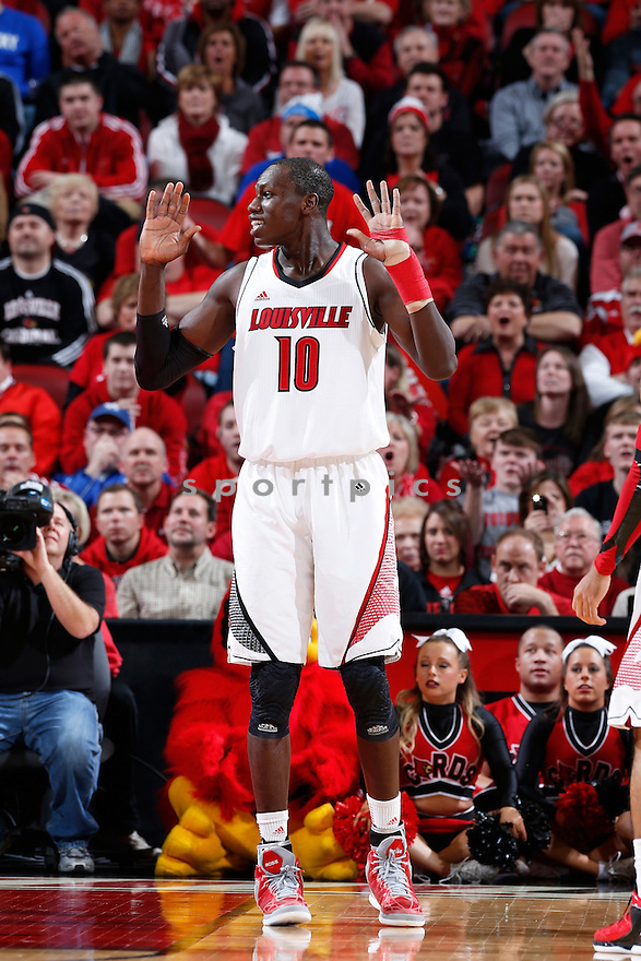 LOUISVILLE, KY - DECEMBER 29: Gorgui Dieng #10 of the Louisville Cardinals reacts after being called for a foul against the Kentucky Wildcats during the game at KFC Yum! Center on December 29, 2012 in Louisville, Kentucky. Louisville won 80-77. Gorgui Dieng