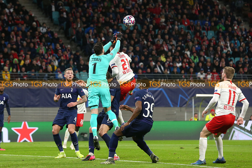 Hugo Lloris of Tottenham Hotspur punches clear during RB Leipzig vs Tottenham Hotspur, UEFA Champions League Football at the Red Bull Arena on 10th March 2020