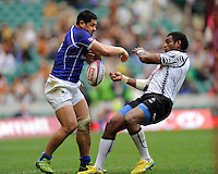 Alafoti Faosiliva of Samoa swats away Nemani Nagusa of Fiji during the iRB Marriott London Sevens at Twickenham on Saturday 11th May 2013 (Photo by Rob Munro)