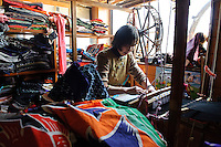 "Kinoyo Ishizuka makes ""sakiori"" cloth goods from old material, Sado island, Niigata, Japan, April 5, 2009..Sado island, off the north coast of Japan's main island, is famous as the home of the Kodo drummers and the annual Earth Celebration arts festival."