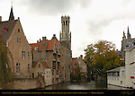 Canal Scene: Djiver at Rozenhoedkaai Red Hat Quay, Wollestraat Hotels, Belfort Bell Tower and Duc de Bourgogne, Bruges, Brugge, Belgium