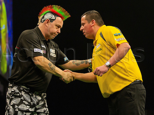 31.03.2016. The Motorpoint Arena, Cardiff.  Betway PDC Premier League Darts Judgement Night. Peter Wright shakes hands with Dave Chisnall after the match