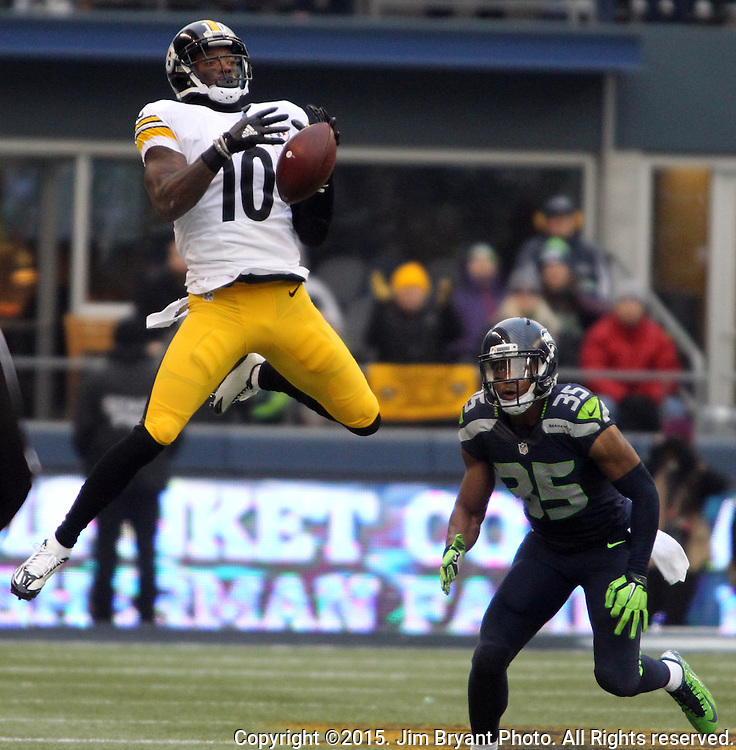 Pittsburgh Steelers wide receiver Martavis Bryant (10) drops a pass while being guarded by Seattle Seahawks defensive back DeShawn Shead (35) at CenturyLink Field in Seattle, Washington on November 29, 2015.  The Seahawks beat the Steelers 39-30.      ©2015. Jim Bryant Photo. All Rights Reserved.