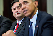 From left, Ron Klain, Ebola Response Coordinator, look on as United States President Barack Obama speaks to the media during a meeting with his national security and public health teams concerning the government's Ebola response, in the Roosevelt Room of the White House, on November 18, 2014, in Washington, DC.  President Obama called on Congress to approve $6.2 billion in emergency spending to fight Ebola in West Africa. <br /> Credit: Drew Angerer / Pool via CNP