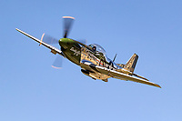 """P-51D Mustang 44-63807 (N20MS) """"Daddy's Girl"""" in flight over Nevada County Airport."""