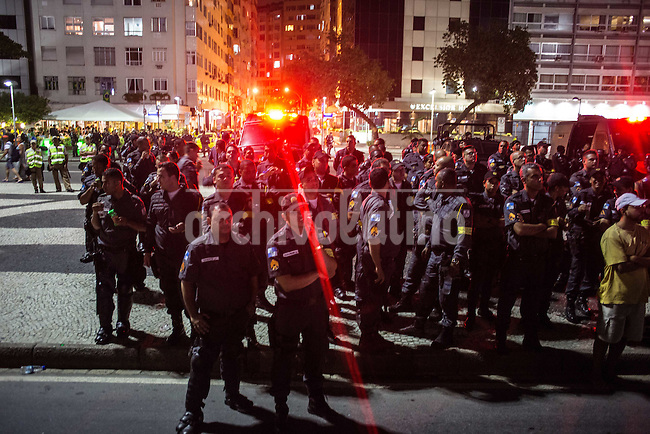 Rio de Janeiro, Brazil.Dozens of demonstrators gathered today in Copacabana, the tourist district of Rio de Janeiro, to protest against the World Cup, while hundreds of fans witnessed on the beach, a few meters, todays opening game of the tournament.